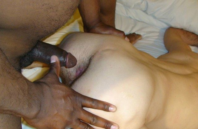 Black top about to slide his raw cock into white hole.