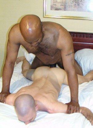 Black top holds down white bottom and fucks him bareback.