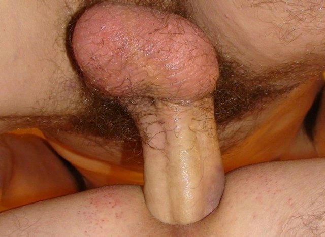 Close-up of raw cock sliding into a shaved hole.