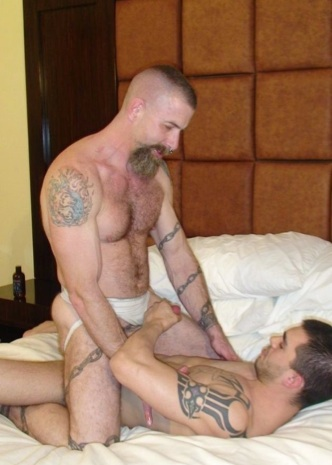 Hairy inked Jake rides Sage's raw cock
