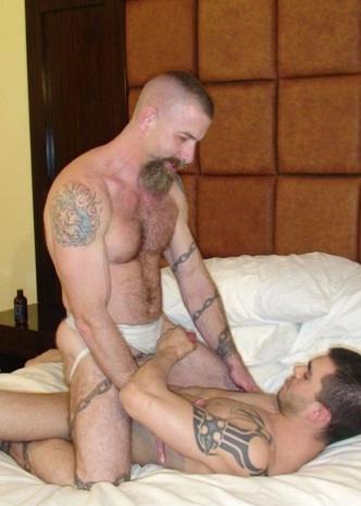 Hairy inked Jake rides Sage's raw cock