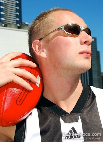Blond Aussie jock poses for a glamour shot with his ball