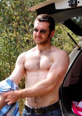 hairy jock boy takes his shirt off