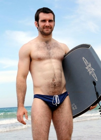 Hot young jock Josh in a speedo at the beach