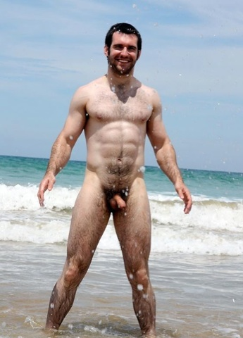 Ripped young muscle cub naked at the beach