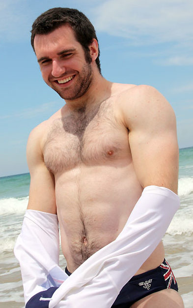 Furry muscle cub stripes at the beach
