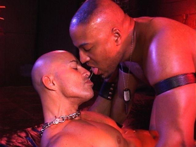 Bald beefy guys swap spit