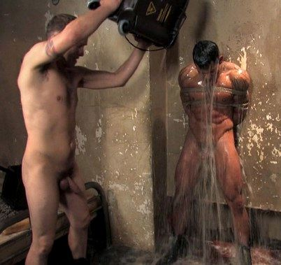 Hot young stud Ash Brooks is bound and gets a bucket of waste water dumped on him by tormentor Rod Barry