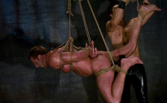 Van hoists Derek pain up in bondage