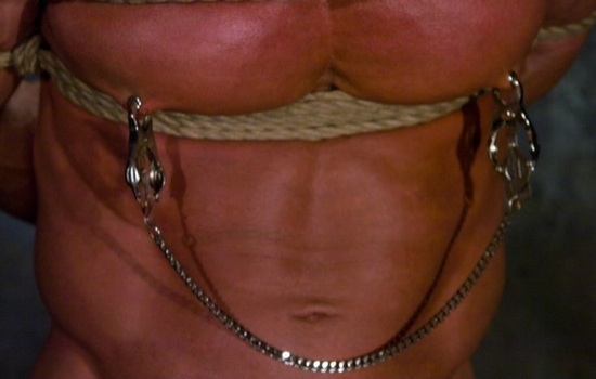 Derek Pain's nipples in clamps