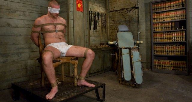 blindfolded and bound to a chair