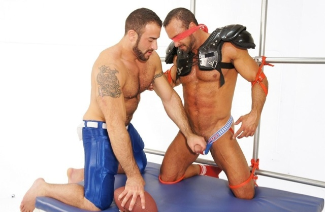 Spencer strokes Nates cock while he is blindfolded