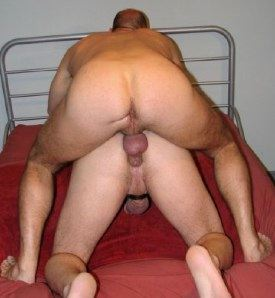 Built stud puts his flacid penis on a guys asshole
