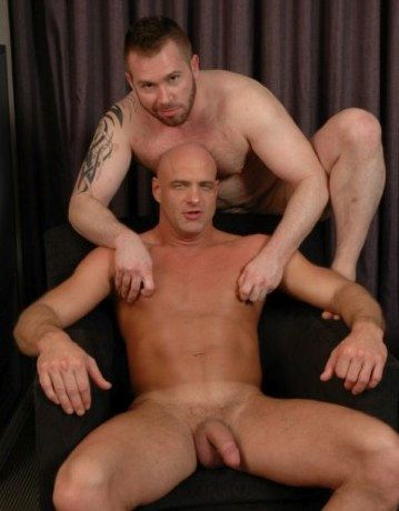beefy furry guy plays with a smooth hunks hard nipples