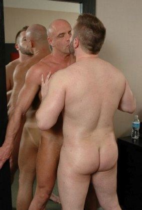Two guys kiss and rub eachothers hot bodies