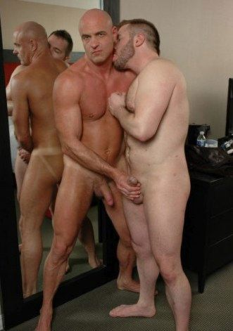 Smooth bodied hunk gets his neck nibbled while he jacks a hard dick