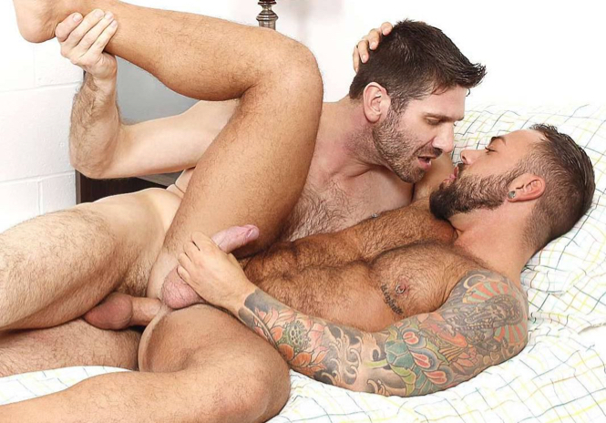Tattooed, hairy muscle bottom shares an intimate bareback fuck with a top