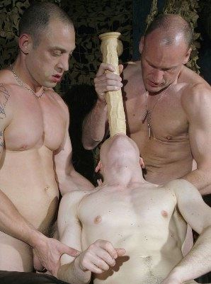 smooth sub gets fed huge dildo in gang bang