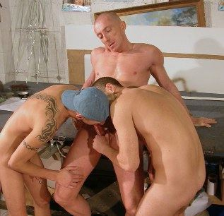 Two guys work a bald guy\'s hard cock