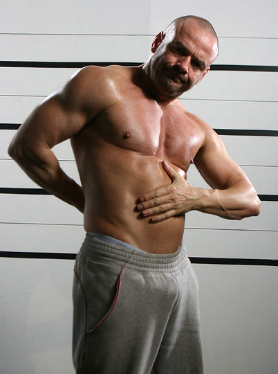 Muscle hunk rubs his hot body and flexes his muscles