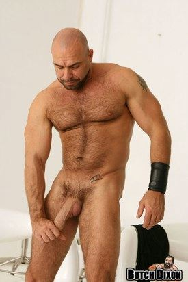 Muscle stud with shaved head tugging on his cock