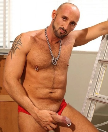 Beefy hairy Pedro showing off his pierced cock