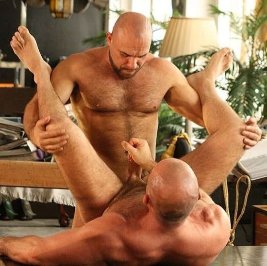 Marco De Brute rubs one out of his big dick while he's pounded by Axel Ryder.