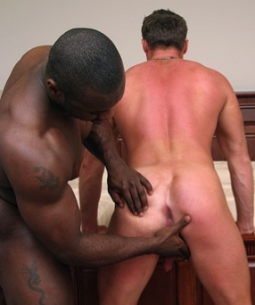 Inked black hunk prepares his bottoms ass for his huge dick