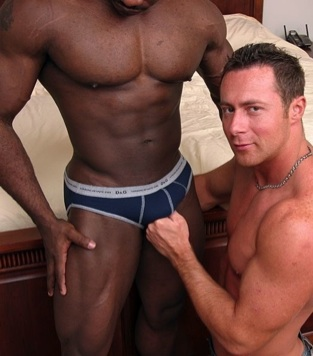 Built white stud plays with a big black cock through underwear
