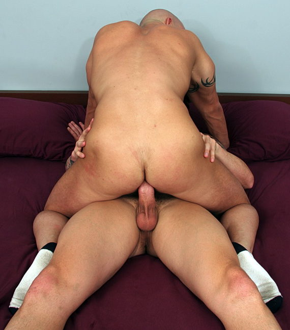 Bald bottom Brock Armstrong rides a big dick bareback