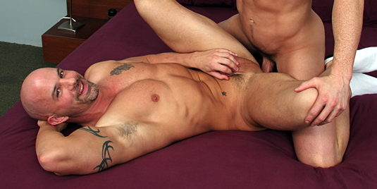 Tattooed bi pretty boy David Taylor fucks bald-headed bottom Brock Armstrong on his back