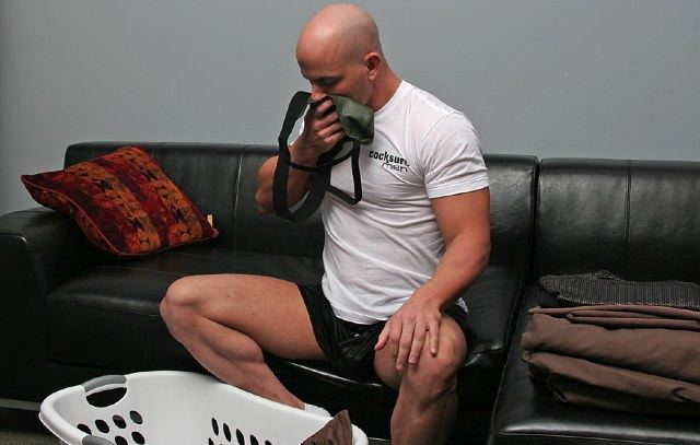 Brock Armstrong sniffs his green leather jock