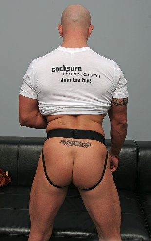 Brock Armstrong in a jockstrap showing off his ass and temporary tramp stamp tattoo