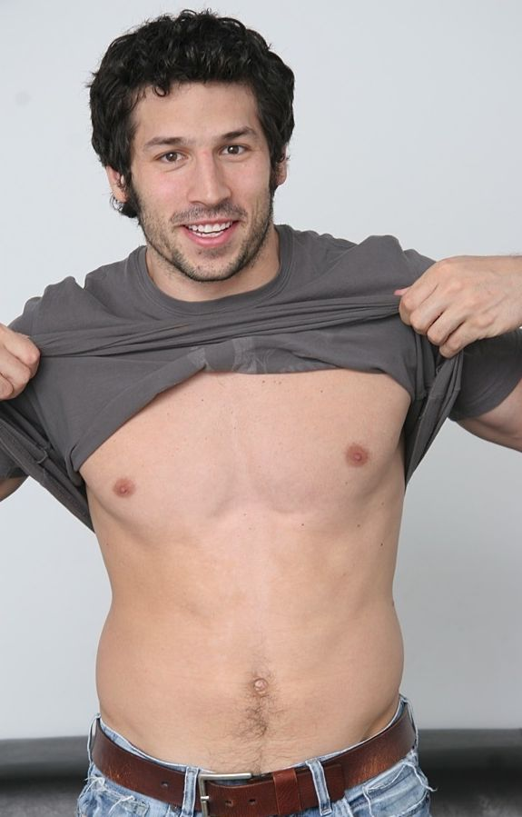 Leo Giamani pulls up his shirt and shows off his nipples