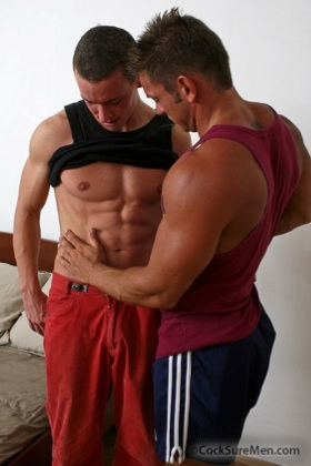 Ripped boy getting felt up by his hunk friend