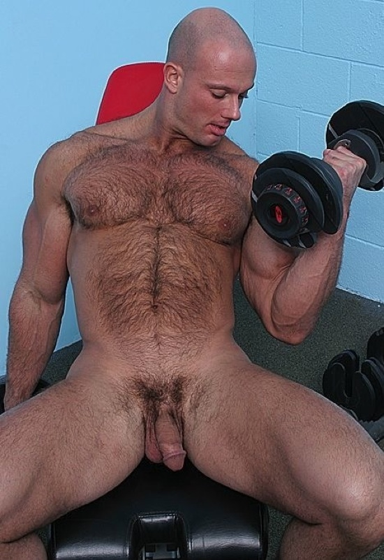 Furry stud lifts some weights and shows his cock