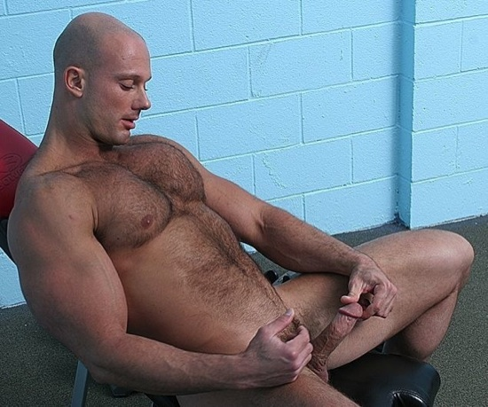 Ripped hunk plays with his big headed dick