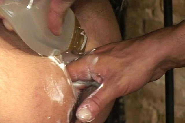 Mike lubes up his hand and Steve's hole