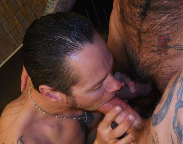Damon Dogg with two cocks in his mouth