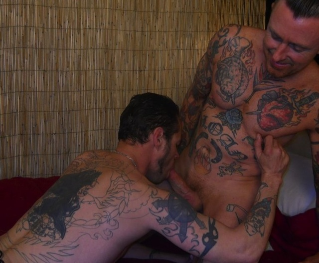 Inked Jesse gets his cock sucked by Damon Dogg