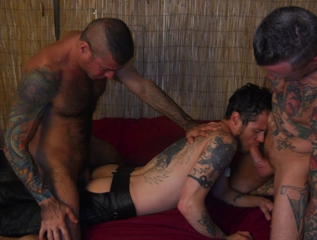 Nick pounds his bare cock into Damon's ass while he works Jesse's dick