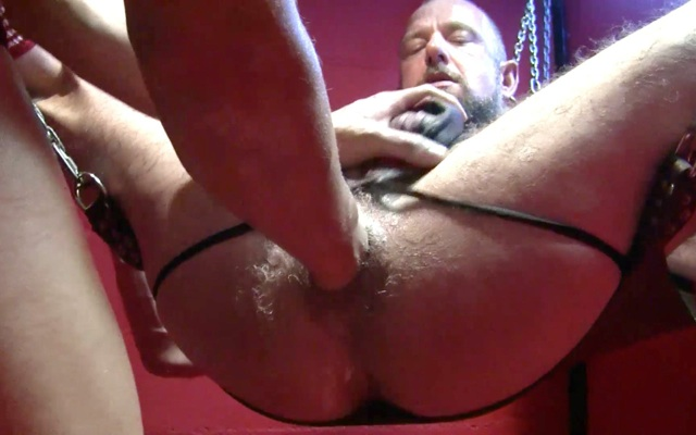Bare fist opens up  beefy hairy ass in a sling