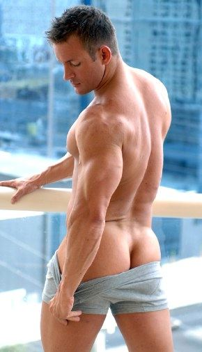 Smooth muscle stud TJ Cummings shows off his beefy bubble ass for the camera.