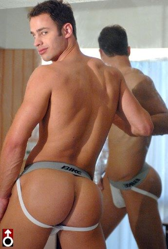 Hot smooth jock Bryan Hawn shows of his bubble ass in Bike jock.