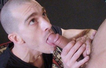 Fred Mayer looks up as Max Ferrow cums in his mouth and on his face