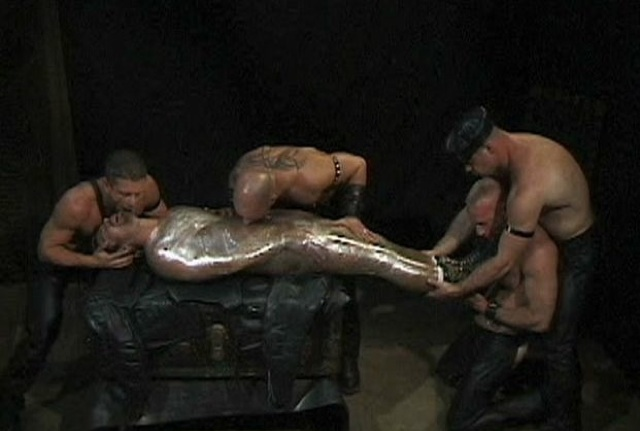 Four leathermen restrain Bryce Pierce in plastic wrap