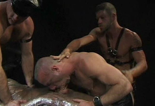Leather man forced down on Bryce's pierced dick