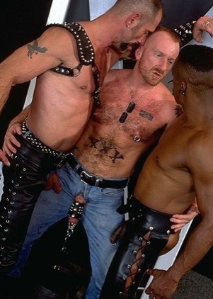 Chris plays with two guys while weights hand from his cock