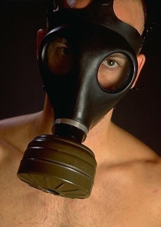 Hot young guy in a gas mask
