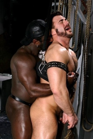 Mick takes Lee's thiuck black cock in his tight ass